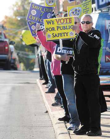 """Retired APD officer Steven Guthrie voices his opposition to a plan to cut seven officers from the police department during a protest at the city building on Thursday. """"My concern is for officer and community safety,"""" Guthrie said."""
