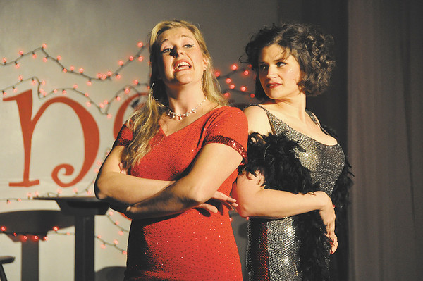 """Actresses Jessica Kim-Cookston, left, and Minday Morton sing of their characters hoping to break free of the dancehall life in """"Baby Dream Tour Dream"""" in the Mainstage Theatre production of """"Swwet Charity."""" The musical runs this weekend and next at the theatre, 124 W. Ninth St."""