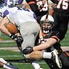 AU linebacker Codie Flecker brings down Bluffton wide receiver Shawn Frost.