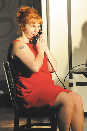"""Tiffany Jackson as Charity Hope Valentine calls a friend to say she is dining with a movie star, played by Gabe Porch, in the Mainstage Theatre production of """"Sweet Charity."""" The musical runs this weekend and next at the theatre, 124 W. Ninth St."""