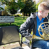 Tyler Claycomb, a sophomore education major, plays the French Horn at the National Association for Music Education booth during Anderson University's homecoming on Saturday.