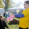 Brian Getz creates a frog for Grace McKinney, 9, during Anderson University's homecoming on Saturday.