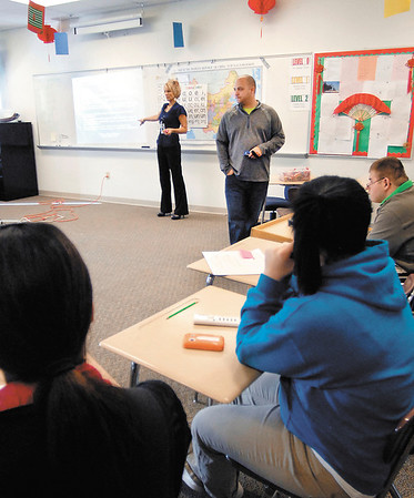 Kandi Floyd and Todd Cawthorn, of Alternatives, Inc., give a dating violence presentation to classes at Anderson High School Monday.