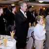 Tom and Bobbette Snyder stand during the Pledge of Allegiance during the annual Book of Golden Deeds Award banquet in the Paramount Theatre Centre ballroom on Thursday. The couple was recognized for their service to the community by the Anderson Noon Exchange Club by receiving the Book of Golden Deeds Award.