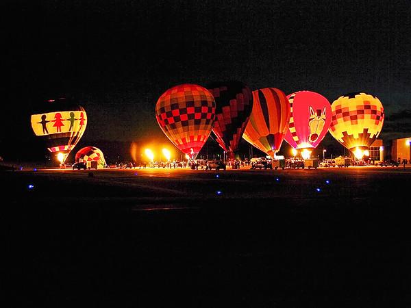 Balloons perform a glow Saturday evening during Balloons Over Killbuck.