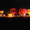 Balloons perform a glow Saturday evening during Balloons Over Killbuck.