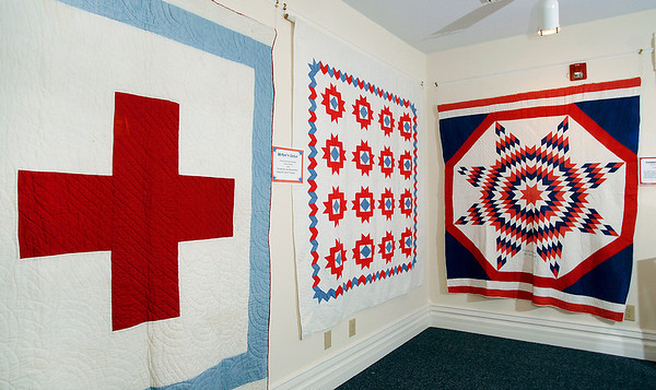 World War II quilt exhibit at the Quilters Hall of Fame in the Marie Webster House located in Marion.  These are the RED CROSS, MOTHER'S CHOICE, AND PATRIOTIC STAR quilts.