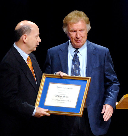 Bill Gaither receives the 2012 Outstanding Music Alumni Award during AU Homecoming chapel from Jeff Wright dean of the college of the arts.
