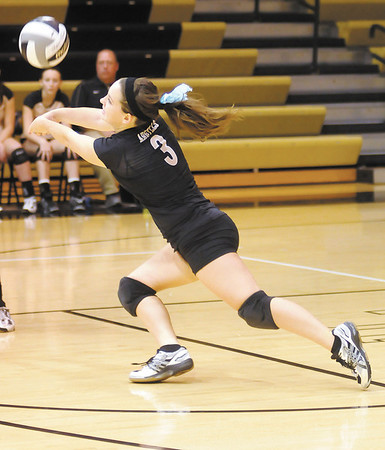 Madison-Grant's Kayla Martin passes the ball as the Argylls faced the Alexandria Tigers in the sectional semi-final on Saturday.