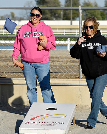 """Hoosier Park held a celebration party for their employees Monday for winning 22 1st place """"Best Of""""  awards from Midwest Gaming & Travel magazine.  Here Kara Fairer and Noelle Lloyd have fun competing playing corn hole."""