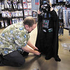 Curtis Clay, of Anderson, helps his daughter Casey, 5, adjust her Darth Vader costume as they shop for Halloween at the Spirit Halloween store in Anderson.