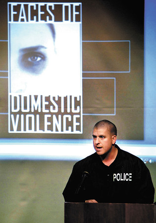 Scott Bertram, Elwood Police assistant chief, talks on law enforcement and domestic violence during Tuesday evenings panel discussion.
