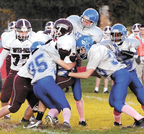 The Anderson Prepatory Academy defense bring down Wes-Del runner Zach Cooper during the Jets Friday night home game.