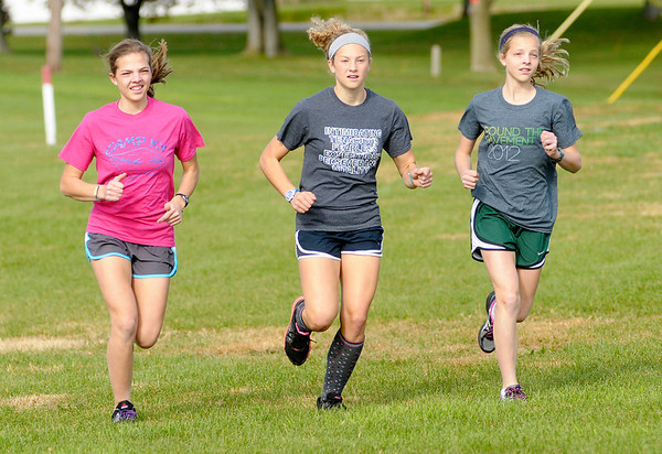 The Dudley sisters, from left, Teresa, Anna and Monica run on the Pendleton Heights cross country team.