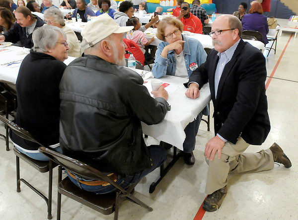 Democratic candidate for governor John Gregg talks with Phill and Leslie Wilhelm and Jeanne Tucker during a visit to the UAW on Saturday.