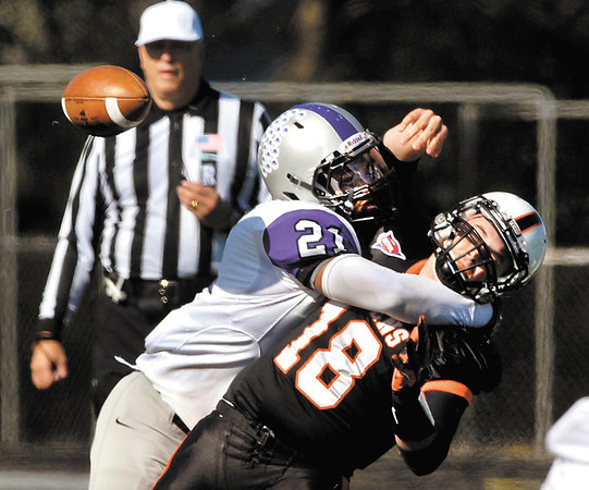AU's quarterback Nate Leeper gets hit by Bluffton's Derek Woods as he tries to throw.  AU recovered the fumble but had to punt.