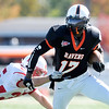 AU running back Marcus Spann breaks a tackle as the Ravens hosted Hanover College during homecoming on Saturday.