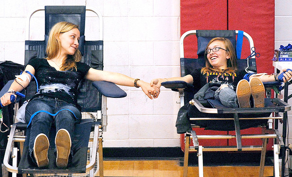 Frankton High School seniors Hailey Camby and Chandra Friend support each other as they donate blood Tuesday morning during the school's  memorial blood drive in honor of three students who died in a tragic car accident in 2005.  The school holds a drive twice a year in honor of the students.<br /> <br /> <br /> <br /> <br /> <br /> Frankton HS holding blood drive in honor of 3 students who died in crash in 2005.