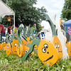 Don Knight/The Herald Bulletin<br /> Michael Carmichael's painted pumpkins are for sale at Alexandria's Small Town USA Festival on Saturday. The festival runs through Sunday.