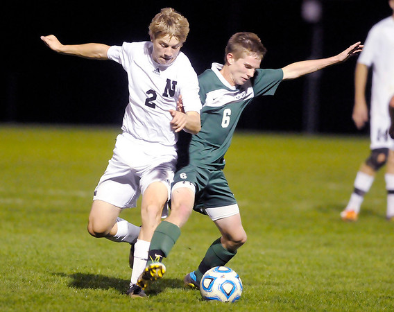 Don Knight/The Herald Bulletin<br /> Pendleton Heights' Tyler Collier and Noblesville's Matt Imel fight for control of the ball during the sectional semi-final at the White River Soccer Fields in Noblesville on Wednesday.