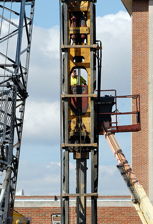 A worker for Beaty Construction uses a lift to get up to, and inspect, the hydraulic hammer on the pile-driving rig being used to put in supports for the new Surgery Pavilion being built at St. Vincent Anderson Regional Hospital.  Construction started on the state-of-the-art surgical facility the first of May with completion targeted for December of 2014.