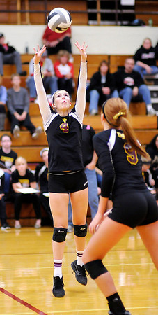 Don Knight/The Herald Bulletin<br /> Alexandria's Makaylea Alberts sets the ball as the Tigers hosted Sheridan during Class 2A sectional action on Thursday.