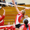 Don Knight/The Herald Bulletin<br /> Elwood's McKenzie Wilson blocks the ball as the Panhters defeated Taylor 3-0 in the opening round of the Class 2A sectional at Alexandria on Tuesday.