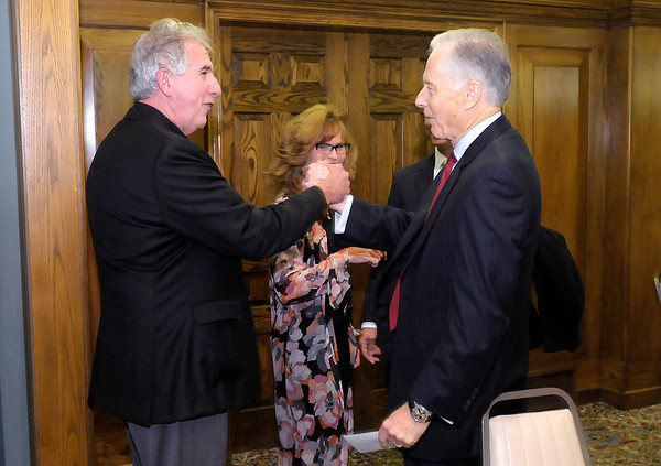 Don Knight/The Herald Bulletin<br /> Jay Ricker greets Chuck Staley at The Anderson Country Club on Thursday where Staley received the 2013 Distinguished Citizen of Madison County award.