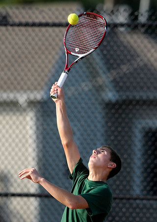 Don Knight/The Herald Bulletin<br /> Pendleton Heights' Sam McKinney returns the ball during the one doubles match during the first round of the boys' tennis sectional at Alexandria-Monroe High School on Wednesday.