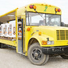 Don Knight/The Herald Bulletin<br /> A modified school bus waits to unload pumpkins fresh from the fields at Howell Farms on Friday. The farm is a hive of activity right now as they harvest more than 500 acres of pumpkins.