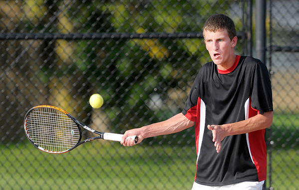 Don Knight/The Herald Bulletin<br /> Frankton's Conner Bates returns the ball to Pendleton Heights' Evan Crooks in the number 3 singles match during the first round of the boys' tennis sectional at Alexandria-Monroe High School on Wednesday.
