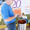 Don Knight/The Herald Bulletin<br /> Glen Burke serves the chili created by the team from Community Parkview Care Center during the Red Gold Chili Cook Off in Elwood on Saturday.