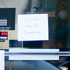 Don Knight/The Herald Bulletin<br /> A hand written sign lets customers know First Merchants Bank on Nichol Avenue is closed after the bank was robbed on Monday.