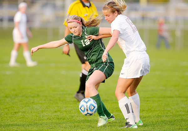 Don Knight/The Herald Bulletin<br /> Pendleton Heights' Emily Church and Fishers' Stacey George fight for control of the ball during the sectional final at Hamilton Southeastern on Saturday.