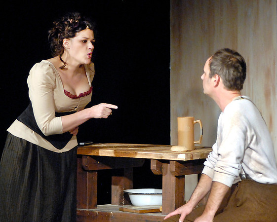 Mrs. Lovett (Mindy Morton) tells Sweeney Todd (Ed Paul Fry) of what has happened during his 15 years of imprisonment.