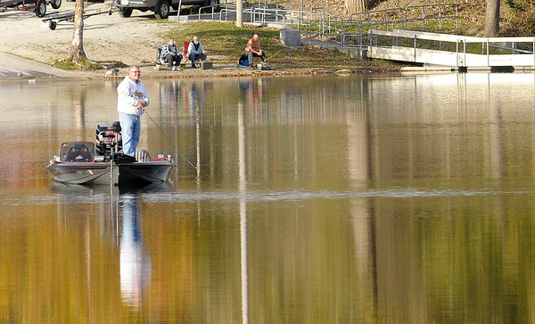 Don Knight/The Herald Bulletin<br /> An angler fishes open water from his boat while several more line the banks at Shadyside on Monday. The parking lot was full of boat trailers and several people tried their luck from the banks as temperatures warmed into the 50s on Monday afternoon.
