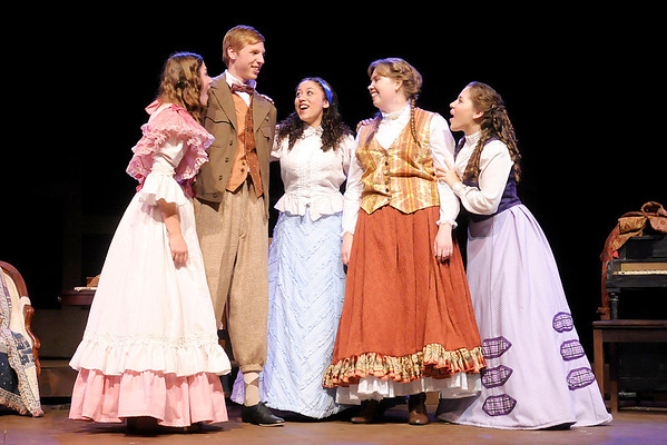 """Don Knight/The Herald Bulletin<br /> Laurie Laurence (Morton Garringer), second from left, is declared by Jo (Chelsea Leis), second from right, as the brother to the sisters in The Boze Lyric Theatre's production of """"Little Women."""""""