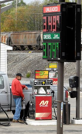 People buying gas at the McClure station on south Main St.