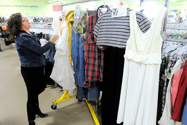 Don Knight/The Herald Bulletin<br /> Vice President of Marketing for Goodwill Industries of Central Indiana Cindy Graham shows some costume ideas for Halloween shoppers at the Goodwill in Anderson.