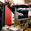 Frankton High School senior Hailey Camby looks down to check her progress in giving blood Tuesday morning during the school's memorial blood drive in honor of three students who died in a tragic car accident in 2005.