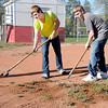 "Don Knight/The Herald Bulletin<br /> From left, Justin McIver and Devon Raper weed the baseball diamond at Shadyside Park as Liberty Christian students fanned out to 15 locations to complete service projects as part of the school's ""Servathon"" on Friday."