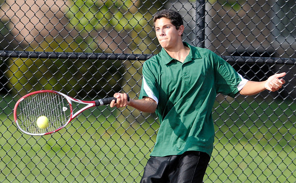 Don Knight/The Herald Bulletin<br /> Pendleton Heights Ben Augsburger returns the ball to Frankton's Lucas Bolt in the number one singles match during the first round of the boys' tennis sectional at Alexandria-Monroe High School on Wednesday.