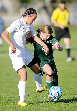 Don Knight/The Herald Bulletin<br /> Anderson's Monica Robinson and Pendleton Heights' Darby Goyer fight for control of the ball in the first round of the soccer sectional at Hamilton Southeastern on Thursday.