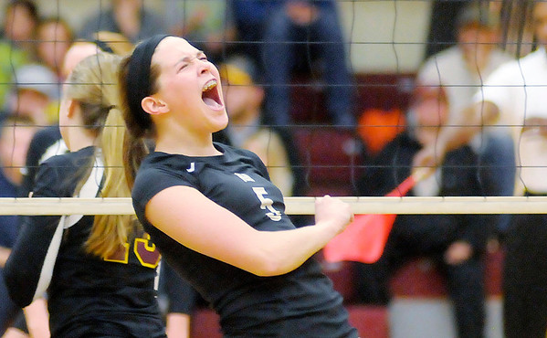 Don Knight/The Herald Bulletin<br /> Madison-Grant's Mallorie Havens reacts after scoring a kill against the Alexandria Tigers in the sectional final on Saturday.