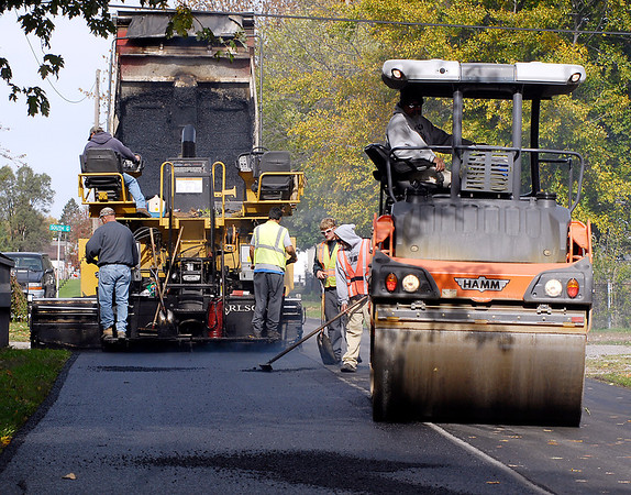 Crews from Grady Brothers Paving of Indianapolis lay down fresh asphalt along South 13th Street in Elwood Tuesday afternoon. They are finishing up a three week project paving two miles of  city streets.