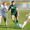 Don Knight/The Herald Bulletin<br /> Pendleton Heights' Sydney McCullum takes a shot on goal as she is defended by Anderson's Lauren Soares (24) and Marissa Childs (6) in the first round of the soccer sectional at Hamilton Southeastern on Thursday. McCullum scored two goals in the Arabians 6-0 win.