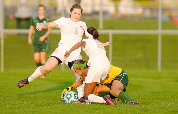 Don Knight/The Herald Bulletin<br /> Pendleton Heights' goalie Sam Hammel saves the ball from Fishers' Brady Riley (6) and Kennedy Turner (12) in the sectional final at Hamilton Southeastern on Saturday.