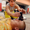 Ryan Paddock stacks cupcakes on Tyler Blanton's forehead during one of the activities of the Red Ribbon Rally Battle of the Schools held at the Impact Center Saturday.  Paddock and Blanton are sophomores at Alexandria High School.<br /> <br /> <br /> <br /> <br /> .