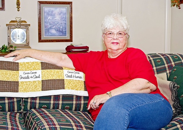 Mark Maynard/For The Herald Bulletin<br /> Squares in breast cancer  survivor Toni Cantrell's quilt are a reminder of things the disease could not take from her life.