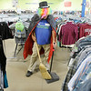 Don Knight/The Herald Bulletin<br /> Goodwill employee Jeff Demos wears a cape, wig and top hat as he works in costume at the Anderson store. Demos creates his costumes from items in the store and mixes it up each day.